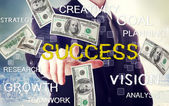Business man with success theme with hundred dollar bills — Stock Photo