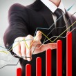 Businessman with Rising Graph — Stock Photo #23097530