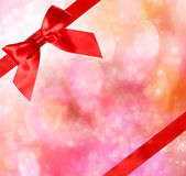 Red Bow and Ribbon with Bokeh Lights — Stock Photo