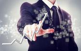 Empresário tocando uma seta ascendente — Foto Stock