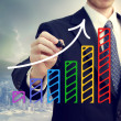 Stock Photo: Businessmdrawing rising arrow