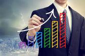 Empresario dibujando una flecha ascendente — Foto de Stock