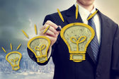 Businness Man with Idea Lightbulbs — Stockfoto