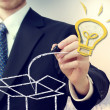 Business man with idea light bulb coming 'out of the box' — Lizenzfreies Foto