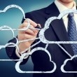 Cloud flow chart with businessman - Stock Photo