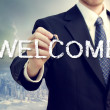 Business man writing WELCOME — Stockfoto