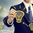 Stock Photo: Businessmwith light bulbs