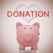Spargris med hjärtat och donation text — Stockfoto