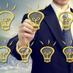 Businessman with light bulbs — Stock Photo