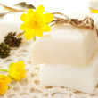 Bars of soap with yellow flowers — Stock Photo