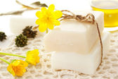 Bars of soap with yellow flowers — Stok fotoğraf