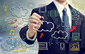Empresário com fotos com tema de computação em nuvem — Foto Stock