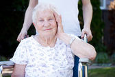 Happy senior lady in wheelchair — Foto Stock