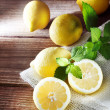Lemons on a rustic wooden table — Stockfoto