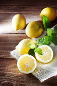 Lemons on a rustic wooden table — Stock Photo