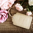 Handmade paper tag with string and roses — Foto de Stock