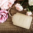 Handmade paper tag with string and roses — Stock Photo #27462989
