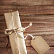 Gift box on rustic wooden table — Stock Photo #27463113