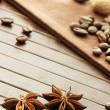 Star anise, coffee beans, nutmeg and cinnamon sticks — Stock Photo #27463293