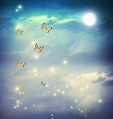 Butterflies in a fantasy moonligt landscape — Stock Photo