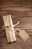Gift box on rustic wooden table — Stock Photo
