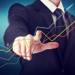 Businessman with Rising Arrows — Stock Photo