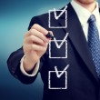 Business man with checkboxes — Stock Photo