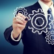 Businessman with gears — Stock Photo