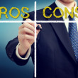 Business man writing pros and cons — Lizenzfreies Foto