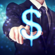 Businessman pointing Dollar icon — Stock fotografie