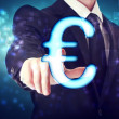 Stock Photo: Businessman pointing Euro icon