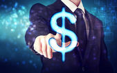 Businessman pointing Dollar icon — Photo