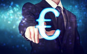 Businessman pointing Euro icon — Stock Photo