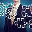 Business Man with Gears and Puzzle Pieces — Stock Photo