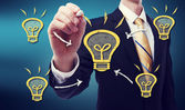 Business Man with Idea Lightbulb — Photo