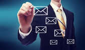 Homme d'affaires avec des enveloppes de courrier électronique — Photo