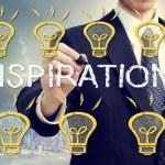 Businessman with idea light bulbs — Stock Photo