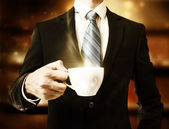 Business Man Holding a Cup of Coffee — Stock Photo
