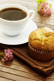 Delicious poppy seed muffins with a cup of coffee — Stock Photo