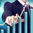 Businessman with Rising Graph — Stock Photo