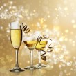 Stock Photo: Glasses on Golden Sparkling Background