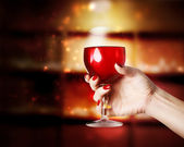 Wine glass being held in a womans hand — ストック写真
