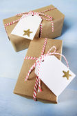 Handcraft giftboxes with ribbons and tags — Stock Photo