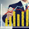 Businessman with graphs representing growth — Stock Photo