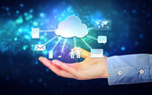 Hand holding hovering cloud computing concept — Stockfoto