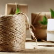 Stock Photo: Hemp cord spool with gift box