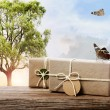 Handmade gift boxes on a fantasy landscape — Stock Photo