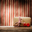 Handmade gift box over striped background — Stock Photo