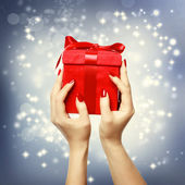 Red present box on Christmas on shinning background — Foto Stock