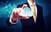 Businessman holding a cloud icon — Photo